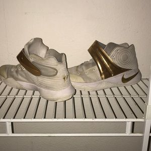 Nikeid gold and white sneakers